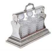A late Victorian silver plated three-bottle tantalus