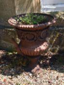 A Victorian cast iron 'Medici style' campana garden urn