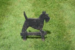 A late Victorian or Edwardian cast iron bootscrape in the form of a Scottish terrier