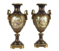A pair of Sevres-style gilt-metal mounted pottery vases