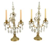 A pair of cut glass and rock crystal mounted gilt metal twin light candelabra in 18th century taste