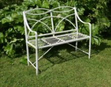 A Regency white painted wrought and cast iron garden seat