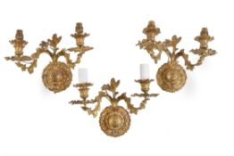 A set of four French gilt metal twin branch wall lights