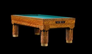 A Continental satin birch and inlaid billiard table