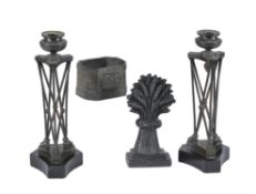 A pair of French patinated and lacquered metal candlesticks in Neoclassical style