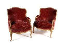 A pair of carved beech and painted tub shaped armchairs