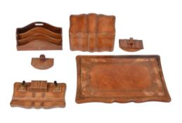 A group of leather clad desk items comprising; a Florentine brown leather envelope casket