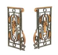 'A pair of Continental, probably French, green and gold painted cast and wrought iron railing ends