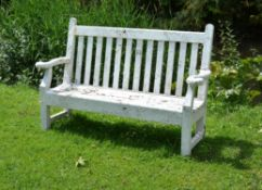 A white painted garden seat