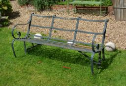 A black painted wrought iron garden bench