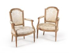 A pair of grey painted and upholstered armchairs in Louis XVI style