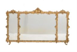 A Victorian giltwood and composition triptych wall mirror