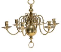 A matched pair of six light brass chandeliers