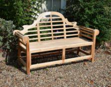 A pair of teak garden benches