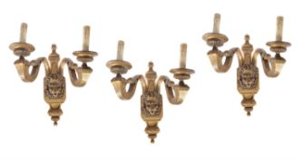 A set of three giltwood and gesso twin branch wall lights in Regence style