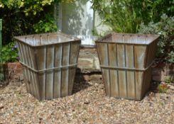 A pair of galvanised metal twin handled planters