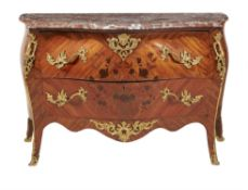 Y A kingwood, tulipwood inlaid, and gilt metal mounted commode in Louis XV style
