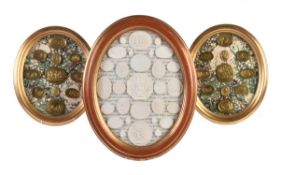 A pair of giltwood framed arrangements of brass intaglio casts after the Antique