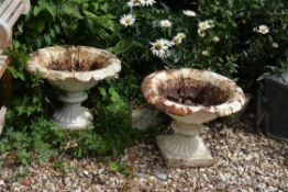 A pair of Victorian white painted cast iron urns