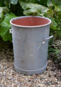 A pair of zinc twin handled vessels utilised as planters