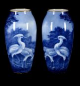 A pair of large Limoges porcelain (M. Frères) ovoid vases signed by N. Etienne