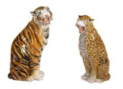 A companion pair of modern red pottery models of big cats