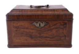 A walnut and feather banded tea caddy