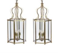 A pair of brass and glazed hexagonal hall lanterns