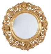 A pair of Italian carved giltwood circular wall mirrors