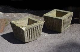 A pair of English stone planters