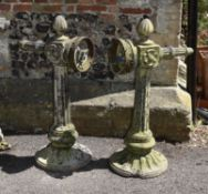 A pair of stone composition exterior light fitments or brackets