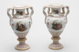 A pair of late 19th century Meissen pedestal urn shaped vases