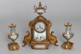 A French gilt metal and Sevres-style clock garniture