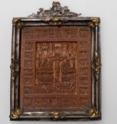 A Gothic style carved boxwood panel carved with the crucifixion