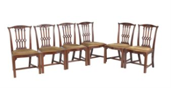 A set of six mahogany dining chairs in the early George III Gothic style