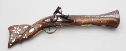 A 19th century Near Eastern flintlock blunderbuss pistol