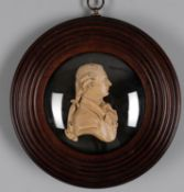 A wax profile portrait medallion of a gentleman