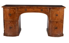 A Regency mahogany and line inlaid serpentine fronted sideboard