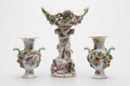 A Meissen flower encrusted figural centrepiece