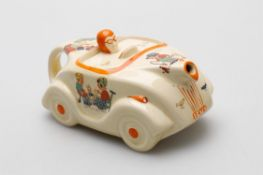 A Sadler pottery Mabel Lucie Attwell racing car novelty nursery teapot