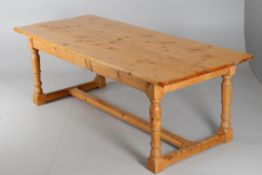A contemporary pine refectory table in the late 17th century manner