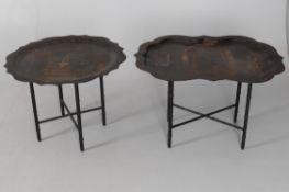 A Victorian black tole peint pie-crust tray table