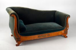 A French Empire style walnut and gilt metal mounted sofa