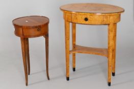 A late 19th century Biedermeier Revival birch and part ebonised two tier single drawer oval occasion