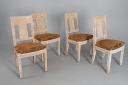 A set of four limed hardwood side chairs