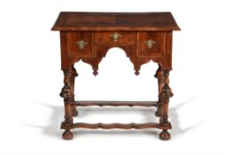 A William & Mary walnut and feather banded side table, circa 1690
