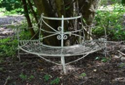 A Regency white painted wrought iron corner or tree seat