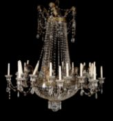 A pair of Continental clear glass and gilt metal mounted twenty-four light chandeliers in early 19th