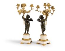 A pair of French gilt bronze and white marble mounted figural four light candelabra