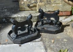 A pair of Regency black painted cast iron boot scrapes